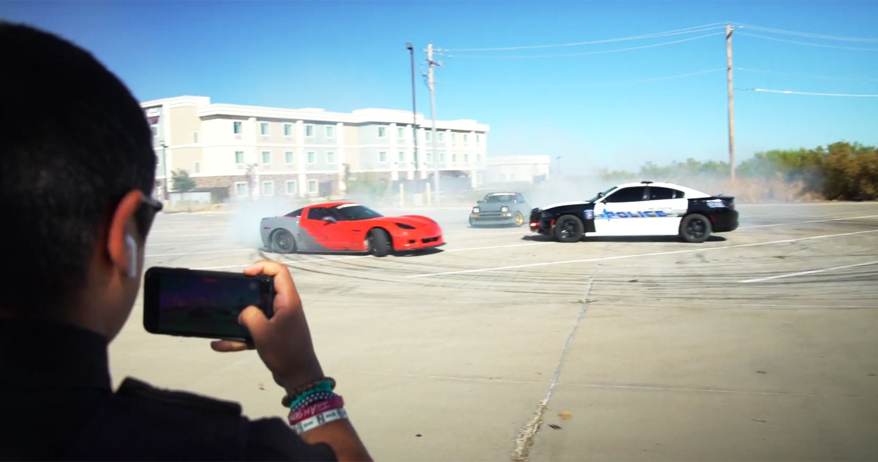 This Cop Is Totally Cool With Letting These Drifters Do Donuts Around His Police Squad Car