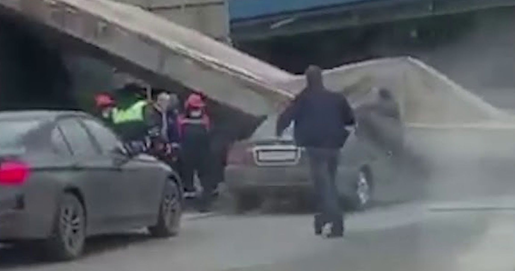 Watch A Russian Driver And His Family Escape Freak Accident As Bridge Collapses Onto Car