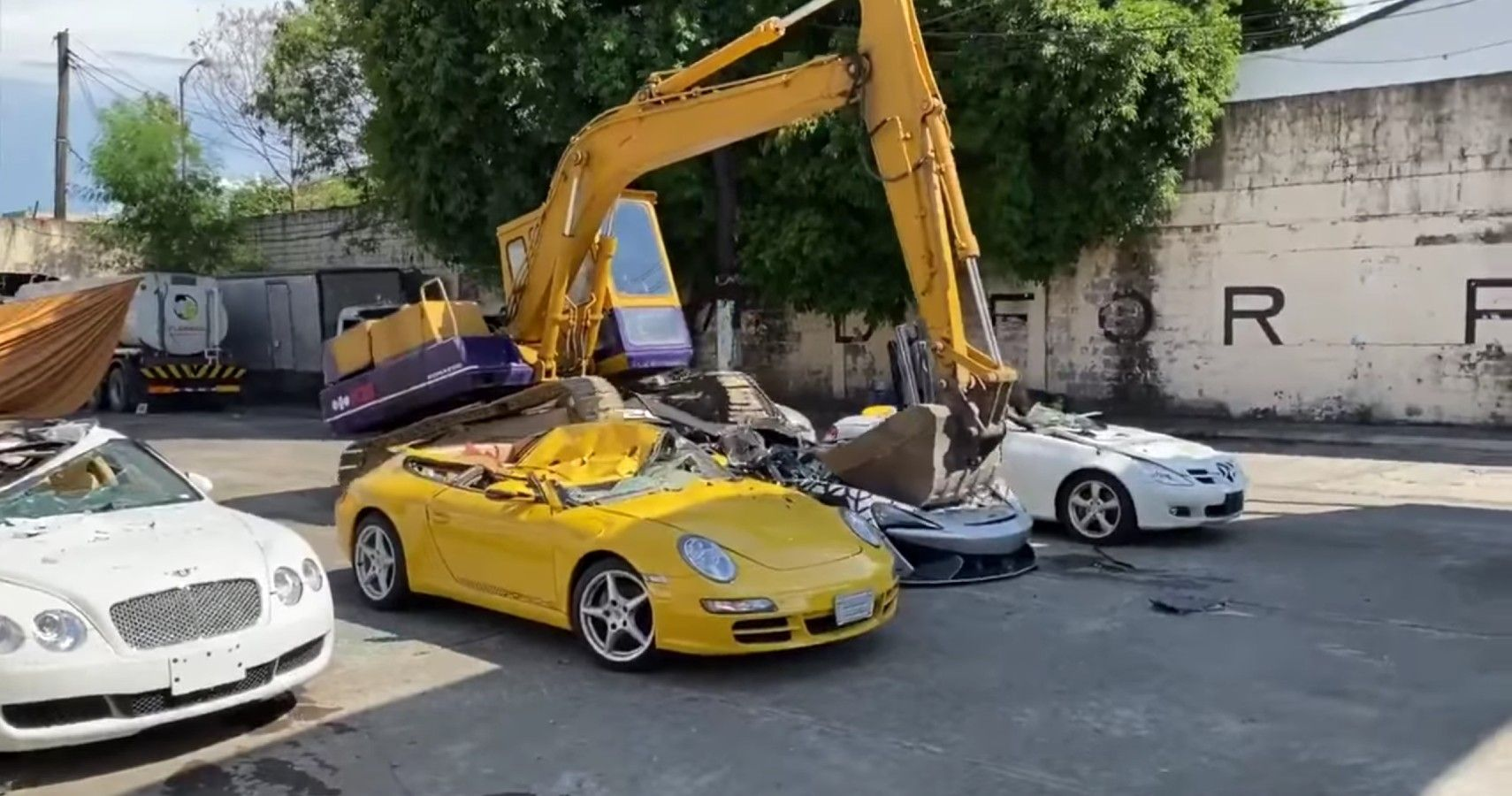 McLaren 620R Among Seven Luxury Cars Crushed By Excavator In Public Demonstration